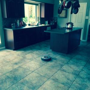 R2 cleaning my kitchen floor
